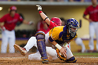 LSU Tigers catcher Ty Ross #26 catches a late throw during the NCAA Super Regional baseball game against Stony Brook on June 10, 2012 at Alex Box Stadium in Baton Rouge, Louisiana. Stony Brook defeated LSU 7-2 to advance to the College World Series. (Andrew Woolley/Four Seam Images)
