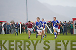 Looking for options Aidan Walsh for St Marys looks up as Dromid's Caoinhín Ó Sé gives chase.