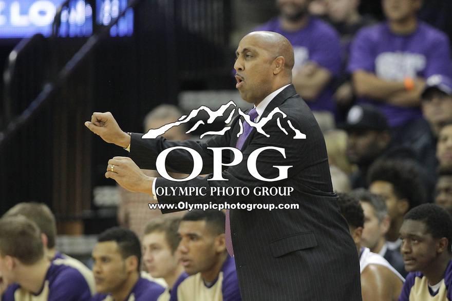 JAN 1, 2016:  Washington head coach Lorenzo Romar instructs his team from the bench against UCLA.  Washington defeated #25 ranked UCLA 96-93 in double overtime at Alaska Airlines Arena in Seattle, WA.