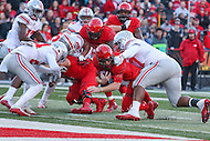 College Park, MD - November 12, 2016: Maryland Terrapins quarterback Caleb Rowe (7) is tackled by several Ohio State Buckeyes defenders during game between Ohio St. and Maryland at  Capital One Field at Maryland Stadium in College Park, MD.  (Photo by Elliott Brown/Media Images International)