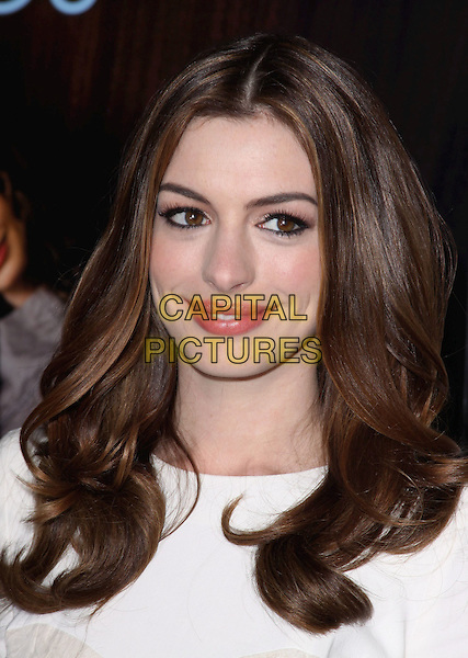 "ANNE HATHAWAY .The AFI Fest 2010 Opening Gala - ""Love & Other Drugs"" World Premiere held at The Grauman's Chinese Theatre in Hollywood, California, USA, .November 4th, 2010..portrait headshot white eyeliner make-up beauty lace  smiling .CAP/ADM/CH.©Charles Harris/AdMedia/Capital Pictures"