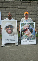 Fairfax,VA August 4 2018, These men found these posters and decided to hold them while demonstrators on both sides of the gun control issue rally at the National headquarters of the National Rifle Association (NRA) in Fairfax, VA.  Dubbed  &quot;The March on the NRA&quot; protestors line the streets in fron the of headquarters.   Patsy MediaPunch<br /> CAP/MPI/PYL<br /> &copy;PYL/MPI/Capital Pictures