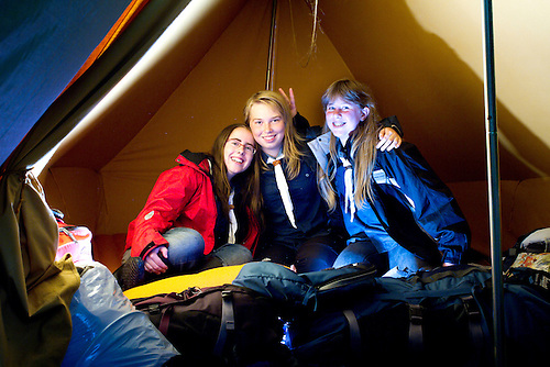 Linnéa, Rebecca and Elin (Sweden) having fun in their tent. Photo: Mikko Roininen / Scouterna