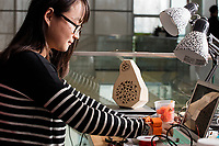 Yuhan Hu, a visiting student from China, works on the Hand Development Kit in the Fluid Interfaces Group lab space at MIT's Media Lab in Cambridge, Massachusetts, USA, seen here on Tues., April 25, 2017. The Hand Development Kit is a prosthetic of sorts that allows a user to have additional fingers and may be used in future applications including typing and musical instrument playing.