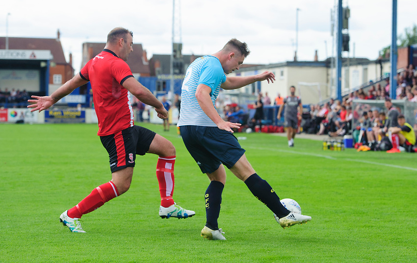 Gainsborough Trinity's Cameron Hough under pressure from Lincoln City's Matt Rhead<br /> <br /> Photographer Chris Vaughan/CameraSport<br /> <br /> Football Pre-Season Friendly (Community Festival of Lincolnshire) - Gainsborough Trinity v Lincoln City - Saturday 6th July 2019 - The Martin & Co Arena - Gainsborough<br /> <br /> World Copyright © 2018 CameraSport. All rights reserved. 43 Linden Ave. Countesthorpe. Leicester. England. LE8 5PG - Tel: +44 (0) 116 277 4147 - admin@camerasport.com - www.camerasport.com