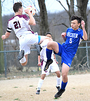 Westside Eagle Observer/MIKE ECKELS<br /> <br /> Emmanuel Thao (Decatur 5) and Holden Wills (21) collide in mid-air trying to get to the ball during the first half of the Decatur-Gentry soccer match in Decatur March 4.