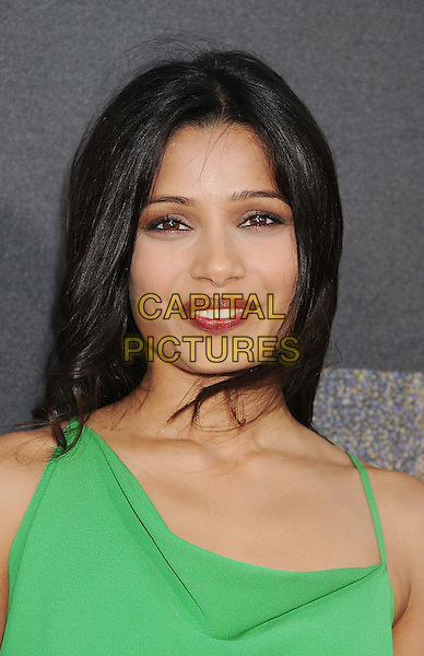 """Freida Pinto.arriving at the Los Angeles premiere of """"Rise Of The Planet Of The Apes"""" at Grauman's Chinese Theatre in Hollywood, California, USA, .July 28th, 2011..portrait headshot make-up red lipstick beauty  green.CAP/ROT/TM.©TM/ROT/Capital Pictures"""