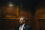 During the middle of a Transportation and Infastructure meeting, congressman Markwayne Mullin has to leave to speak to a group of Oklahoma Fire Marshals in another building near the U.S. Capitol on Sept. 19, 2013.