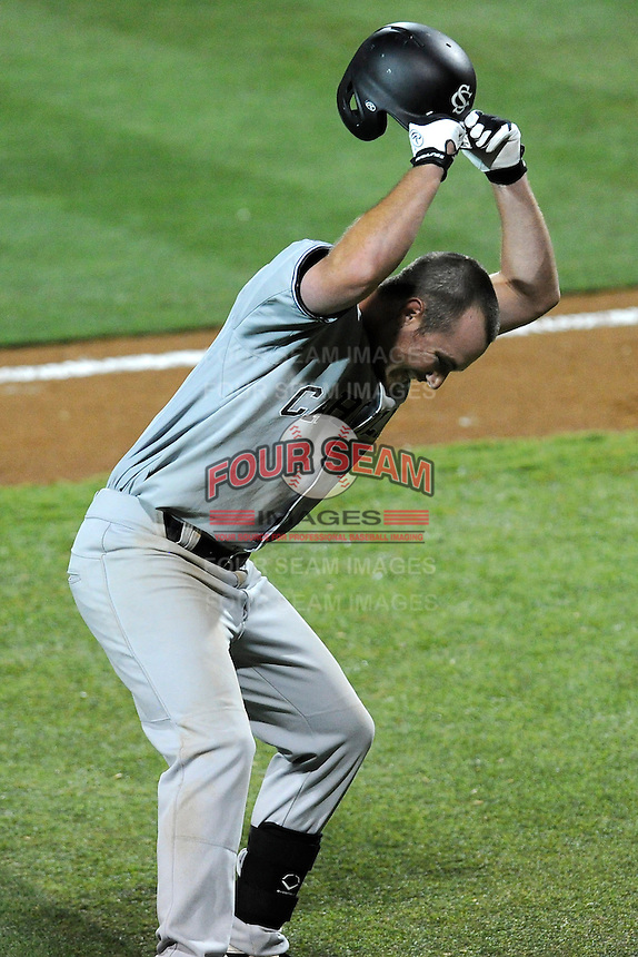 Joey Pankake (9) of the South Carolina Gamecocks slams his helmet to the ground after hitting into a game-ending double play in an NCAA Division I Baseball Regional Tournament game against the Maryland Terrapins on Saturday, May 31, 2014, at Carolina Stadium in Columbia, South Carolina. Maryland won, 4-3. (Tom Priddy/Four Seam Images)