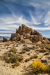 Boulders set against a dramatic partly cloudy sky in the Alabama Hills near Lone Pine.