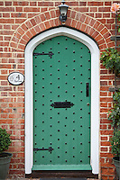 Studded arched door by Stratfield Saye House, Hampshire, United Kingdom