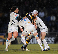 Wycombe, GREAT BRITAIN, Wasps' James HASKELL tackled by  left left Sebastien BRUNO, centre, Chris JONES  and right, Charlie HODGSON, during the Guinness Premiership game, London Wasps vs Sale Sharks 15.04.2008 [Mandatory Credit Peter Spurrier/Intersport Images]
