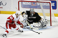 03/02/11 Anaheim, CA: Detroit Red Wings center Darren Helm #43 and Anaheim Ducks goalie Dan Ellis #38 during an NHL game between the Detroit Red Wings and the Anaheim Ducks at the Honda Center. The Ducks defeated the Red Wings 2-1 in OT.