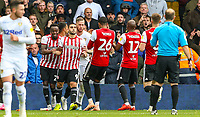 Leeds United's Pontus Jansson leads Brentford goalscorer Neal Maupay away from the Leeds fans after he celebrated in front of them<br /> <br /> Photographer Alex Dodd/CameraSport<br /> <br /> The EFL Sky Bet Championship - Leeds United v Brentford - Saturday 6th October 2018 - Elland Road - Leeds<br /> <br /> World Copyright &copy; 2018 CameraSport. All rights reserved. 43 Linden Ave. Countesthorpe. Leicester. England. LE8 5PG - Tel: +44 (0) 116 277 4147 - admin@camerasport.com - www.camerasport.com