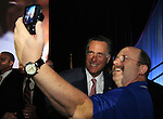 Republican presidential candidate Mitt Romney poses for a photo with an undentified attendee following his address at the 134th National Guard Association of the United States national convention in Reno, Nev., on Tuesday, Sept. 11, 2012..Photo by Cathleen Allison