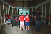 Denver, CO - Wednesday, June 18, 2014:  Chile fans watch their team playing Spain in a World Cup first round match in Thornton, CO.  They were among two dozen Chileans who gathered to watch the match at a private screening room in a condominium complex in suburban Denver.