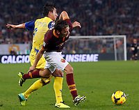 Calcio, Serie A: Roma vs ChievoVerona. Roma, stadio Olimpico, 31 ottobre 2013.<br /> ChievoVerona midfielder Simone Bentivoglio, left, and AS Roma forward Adem Ljajic, of Serbia, fight for the ball during the Italian Serie A football match between AS Roma and ChievoVerona at Rome's Olympic stadium, 31 October 2013.<br /> UPDATE IMAGES PRESS/Riccardo De Luca