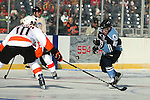 OMAHA, NE - FEBRUARY 9:  Eric Scheid #39 from the Lincoln Stars flips the puck into the Omaha zone past Dominic Racobaldo #10 from the Omaha Lancers in the second period at the Battle on Ice Saturday at TD Ameritrade in Omaha, NE. (Photo by Dave Eggen/Inertia)