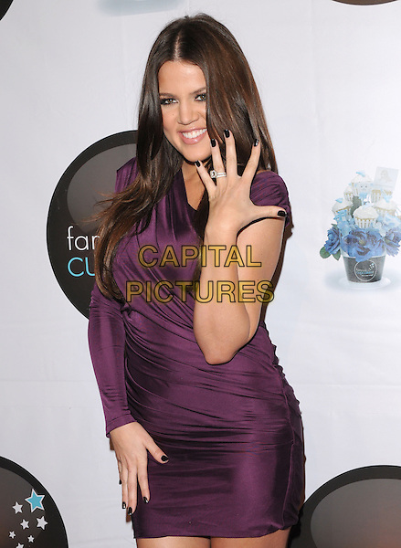 KHLOE KARDASHIAN.at The Famous Cupcakes Beverly Hills Grand Opening, Beverly Hills, California, USA, October 7th,2009..half length one sleeve purple dress ruched hand showing wedding ring diamond nail varnish polish nails .CAP/DVS.©DVS/RockinExposures/Capital Pictures.