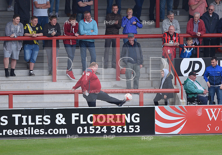07/05/2016 Sky Bet League Two Morecambe v York City<br /> Close control from a Morecambe supporter