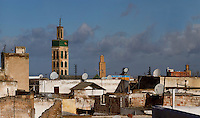 Skyline, Meknes, Morocco pictured on December 26, 2009. A minaret soars over house roofs, many of them with satellite. dishes Meknes, one of Morocco's Imperial cities, was redeveloped under Sultan Ismail Moulay (1634-1727). It is a fortified city built from pise, or clay and straw, and was designed to be the political capital of Morocco, as opposed to Fez, the religious capital. Picture by Manuel Cohen