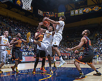 California's Richard Solomon & Tyrone Wallace tries to regain a loose ball during a game against USC at Haas Pavilion in Berkeley, California on February 23th, 2014. California defeated USC 77 - 64