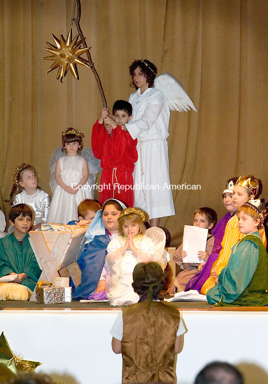 THOMASTON, CT- 16 DECEMBER 2006-121606JS01-The Little Drummer Boy, played by Justin Normandin, foreground, plays for the baby Jesus during a performance of the St. Thomas Church's Christmas pageant Saturday at St. Thomas Church in Thomaston. <br /> Jim Shannon/Republican-American