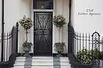 Entrance to house in Eaton Square, Belgravia, London UK