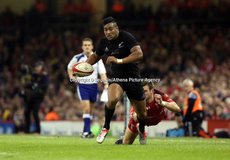 Pictured: Julian Saveo of New Zealand avoids a Wales tackleSaturday 22 November 2014<br /> Re: Dove Men Series 2014 rugby, Wales v New Zealand at the Millennium Stadium, Cardiff, south Wales, UK.