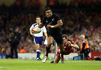 Pictured: Julian Saveo of New Zealand avoids a Wales tackleSaturday 22 November 2014<br />