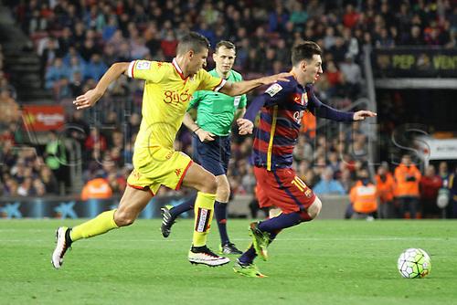 23.04.2016. Nou Camp, Barcelona, Spain. La Liga. Barcelona versus Sporting de Gijón. Messi outruns his defender during the match