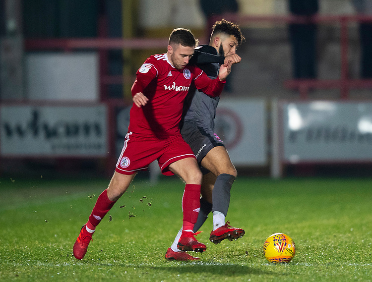 Lincoln City's Kellan Gordon battles with Accrington Stanley's Jordan Clark<br /> <br /> Photographer Andrew Vaughan/CameraSport<br /> <br /> The EFL Checkatrade Trophy Second Round - Accrington Stanley v Lincoln City - Crown Ground - Accrington<br />  <br /> World Copyright © 2018 CameraSport. All rights reserved. 43 Linden Ave. Countesthorpe. Leicester. England. LE8 5PG - Tel: +44 (0) 116 277 4147 - admin@camerasport.com - www.camerasport.com