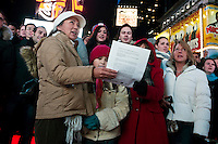 "New York, NY -  21 December 2012 Over 500 people filled the red steps in Times Square to sing John Lennon's song ""Imagine""  Several hundred more gathered in the mall of Duffy Square to sing along...The song was lead by Thomas McCarger, conductor and singer, and under the auspices of Make Music New York, while IMAGINE PEACE lit up the Times Square billboards at 11:57 p.m."