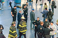 First responders milling about after hundreds of people stampede out of Penn Station in New York on Friday, April 14, 2017 after an unfounded active shooter report.  (© Richard B. Levine)