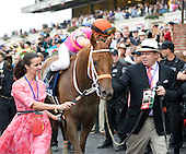 Lori and George Hall lead their Ruler On Ice down victory lane after the Belmont.