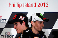 Honda MotoGP rider Marc Marquez of Spain and Yamaha MotoGP rider Jorge Lorenzo of Spain cross each other at the end of the official press conference ahead of the Australian Grand Prix in Phillip Island near Melbourne October 17, 2013. IMAGE RESTRICTED TO EDITORIAL USE ONLY- STRICTLY NO COMMERCIAL USE.  Photo by Daniel Munoz/VIEWpress