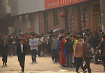 Beijing China 1990s. Migrant labour force workers queue for their trains back to their home towns in the country 1998