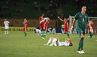 Italy's Marco Calderoni (6) covers his face as the Hungarian team celebrates their overtime win against Italy during the FIFA Under 20 World Cup Quarter-final match at the Mubarak Stadium  in Suez, Egypt, on October 09, 2009. Hungary won 2-3 in overtime.