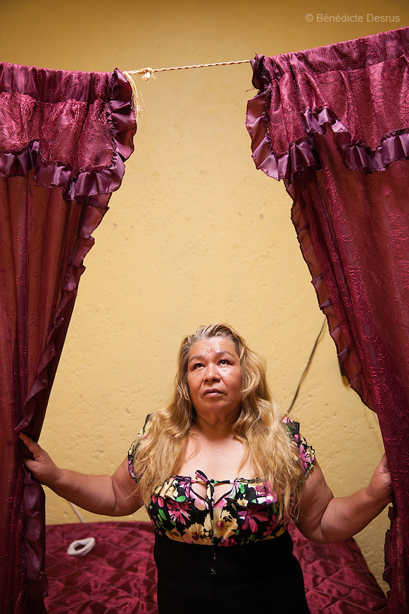 Soledad, a resident of Casa Xochiquetzal, in her bedroom in Mexico City, Mexico on May 27, 2014. Casa Xochiquetzal is a shelter for elderly sex workers in Mexico City. It gives the women refuge, food, health services and a space to learn about their human rights, as well as courses to help them rediscover their self-confidence and deal with traumatic aspects of their lives. Casa Xochiquetzal provides a space to age with dignity for a group of vulnerable women who are often invisible to society at large. It is the only such shelter existing in Latin America. Photo by Benedicte Desrus