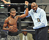 Titus Williams, an Elmont native who made his professional debut, left, raises his arm in triumph after defeating Micah Branch by unanimous decision in a Premier Boxing Champions match at the Barclays Center on Saturday, August 1, 2015.<br /> <br /> James Escher