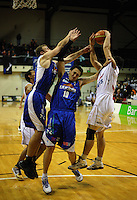 Giants forward Darryl Jones beats Leon Henry and Nick Horvath (left) to a rebound during the NBL match between the Wellington Saints and Nelson Giants at TSB Bank Arena, Wellington, New Zealand on Friday, 21 May 2010. Photo: Dave Lintott / lintottphoto.co.nz