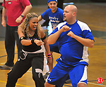 WATERBURY, CT-31 JANUARY 2009-013110JS10-Zumba fitness instructor Cherrie Lamb, left, works with Jesse Taylor of Rocky Hill in a Zumba-thon on Sunday at Chase Collegiate School's Goss Field House. The event was held to raise money for Haitian relief. Participants made a donation of $15, which went to the American Red Corss. Zumba is a style of intense dance-aerobics set to pulsating Latin music. <br /> Jim Shannon Republican-American