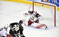 HERSHEY, PA - JANUARY 05: Hershey Bears center Brian Pinho (28) scores a goal over top of Grand Rapids Griffins goalie Harri Sateri (29) during the Grand Rapids Griffins vs. Hershey Bears AHL game at the Giant Center in Hershey, PA. (Photo by Randy Litzinger/Icon Sportswire)
