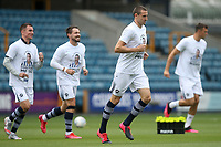 Millwall players take to the field for the warm ups during Millwall vs Swansea City, Sky Bet EFL Championship Football at The Den on 30th June 2020