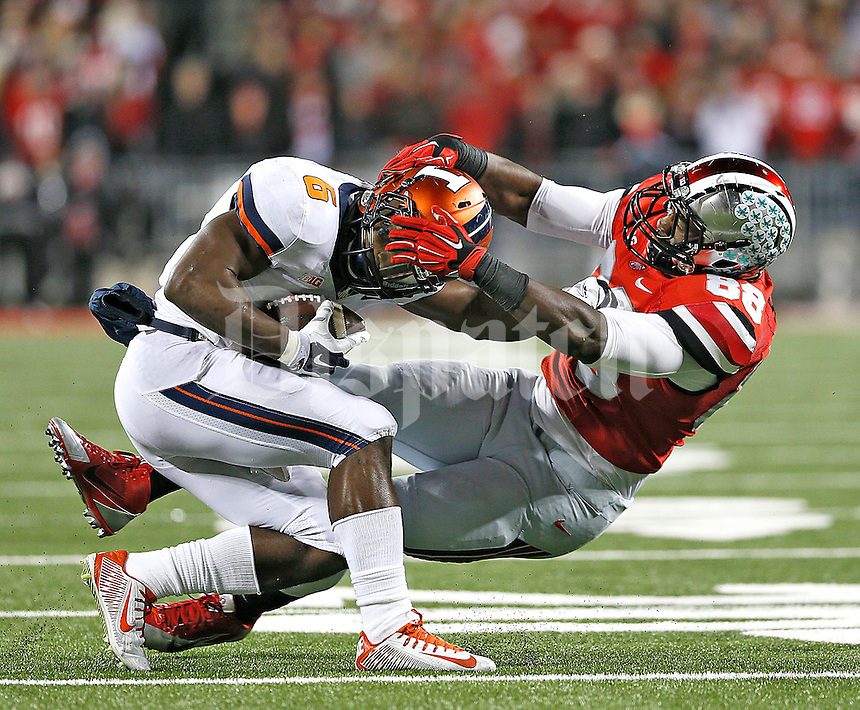 Ohio State Buckeyes defensive lineman Steve Miller (88) brings down Illinois Fighting Illini running back Josh Ferguson (6) at Ohio Stadium on November 1, 2014. (Chris Russell/Dispatch Photo)