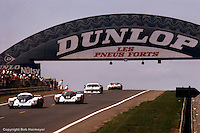 LE MANS, FRANCE: The race-winning Porsche 956 002 driven by Jacky Ickx and Derek Bell leads the Porsche 956 003 of Jochen Mass and Vern Schuppan down the hill after the Dunlop Bridge during the 24 Hours of Le Mans on June 20, 1982, at Circuit de la Sarthe in Le Mans, France.