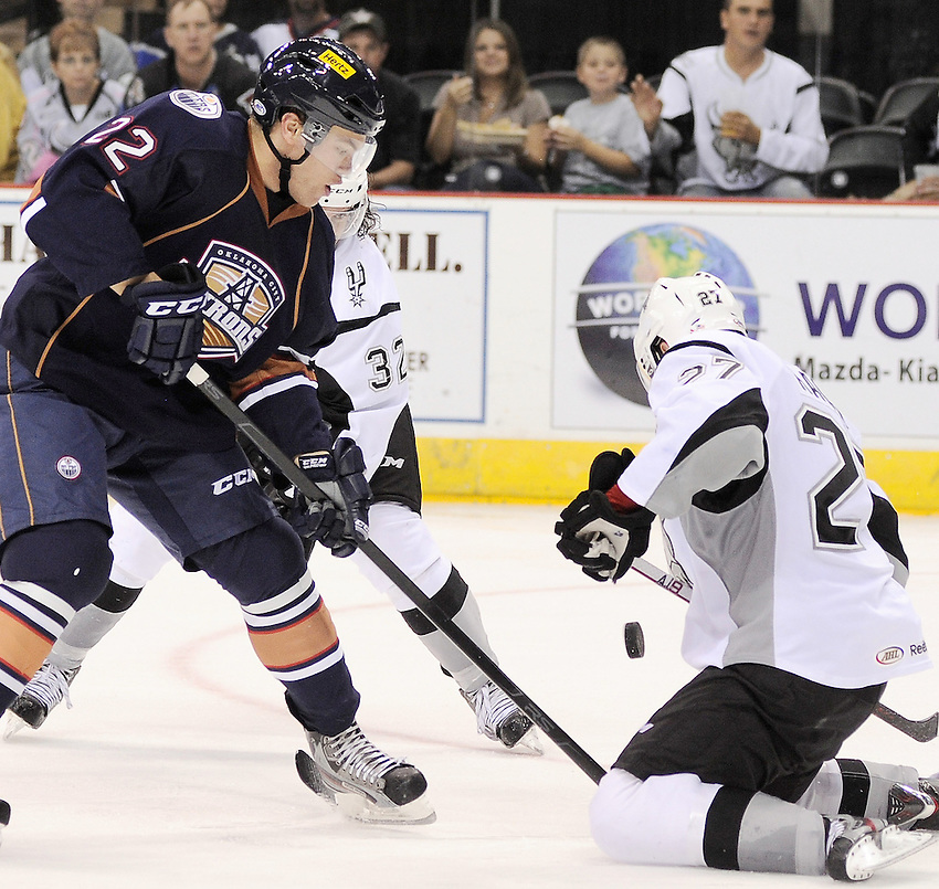 Oklahoma City Barons' Taylor Hall, left, battles San Antonio Rampage's Greg Rallo for the puck during the third period of an AHL hockey game, Sunday, Nov. 4, 2012, in San Antonio. San Antonio won 2-0. (Darren Abate/pressphotointl.com)