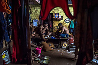 Kushti wrestlers eat their dinner together after the days training at Gangavesh Talim on the 16th of September, 2017 in Kolhapur, India.  <br /> Photo Daniel Berehulak for Lumix