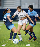 NWA Democrat-Gazette/BEN GOFF @NWABENGOFF<br /> Megan Gotwalt (12) of Bentonville battles with Alexis Fiorentino (8) and Gisselle Estrada of Springdale Har-Ber Tuesday, March 12, 2019, during the match at Wildcat Stadium in Springdale.