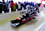 18 December 2010: Maximilian Arndt pushes his 2-man bobsled for Germany, finishing 8th for the day at the Viessmann FIBT World Cup Bobsled Championships on Mount Van Hoevenberg in Lake Placid, New York, USA. Mandatory Credit: Ed Wolfstein Photo